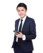Young businessman with cellphone — Stock Photo