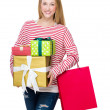 Woman holding shopping bag and gift box — Stock Photo #58845689