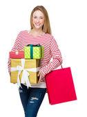 Woman holding shopping bag and gift box — Foto de Stock