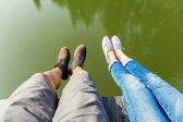 Couple legs wite lake — Stock Photo