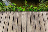 Wooden floor over the river — Stock Photo