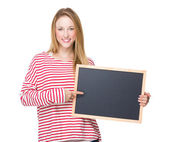 Beautiful woman with chalkboard — Stock Photo