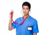 Male doctor using stethoscope — Stock Photo