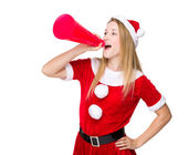 Christmas woman shouting with megaphone — Stock Photo