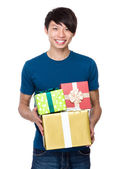 Man with lots of present boxes — Stock Photo