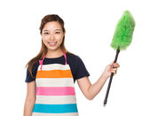 Housewife hold with duster brush — Stock Photo