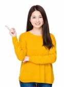 Woman with finger pointing up — Stock Photo