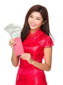 Woman with lucky money with USD — Stock Photo