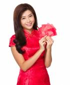 Woman with red pocket money — Stock Photo