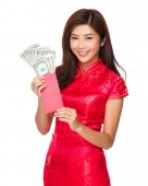 Woman holding pocket money with USD — Stock Photo