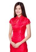Žena v červených šatech — Stock fotografie
