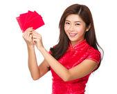 Woman holding pocket money — Stock Photo