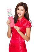 Woman holding pocket money with RMB — Stock Photo