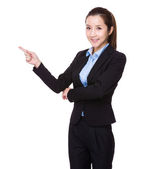 Businesswoman with finger point up — Stock Photo