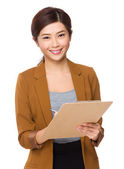 Asian businesswoman in brown jacket — Stock Photo