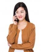 Asian woman in brown cardigan — Stock Photo