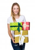 Woman with lots of gift boxes — Stock Photo