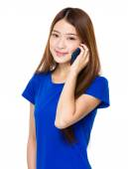 Asian woman in blue t shirt — Stock Photo