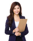 Asian businesswoman in business suit — Stockfoto