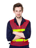 Construction worker with arms crossed — Stock Photo