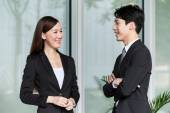Businesswoman and businessman discuss together — Stock Photo