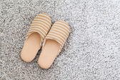 Slippers on grey carpet — Stock Photo