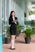 Asian businesswoman using tablet — Stock Photo