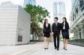 Business people walking along the street — Stock Photo