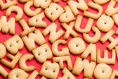 Word biscuit over red background — Stock Photo