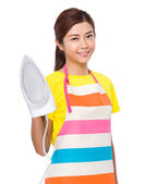 Young asian housewife in apron — Stock Photo