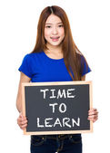 Asian woman in blue t-shirt with blackboard — Stock Photo
