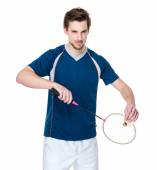 Badminton player in blue t-shirt with racket — Stock Photo