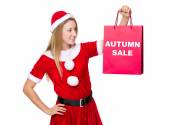 Woman in christmas costume with shopping bag — Stock Photo