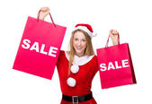 Kvinna i jul kostym med kassar och påsar — Stockfoto