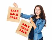 Caucasian woman holding shopping bags — Stock Photo