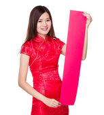 Chinese young woman in red dress — Stock Photo