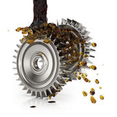Greasing cogwheels — Stock Photo