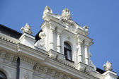 Latvia, Riga. Superstructure on a house roof in the form of juge — Stock Photo