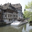 France, Strasbourg. The pleasure boat with tourists on the chann — Stock Photo #57261677