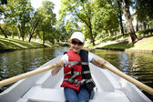 The girl in the boat on oars on the channel  — Stock Photo