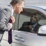 Businessman adjusting tie — Stock Photo #57268719