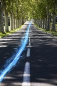 Streak of light on country road — Stock Photo