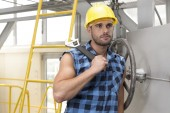 Worker  leaning on industrial valve — Stock Photo