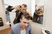 Barber using hairspray — Stock Photo