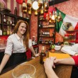 Bartender with male customers — Stock Photo #57270069