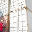 Worker inspecting cargo containers — Stock Photo #57271047