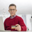 Man using credit card to shop online — Stock Photo #57271719