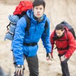 Male backpackers hiking in forest — Stock Photo #57271841
