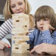 Family playing with wooden blocks — Stock Photo #57272189