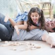Daughter on top of father — Stock Photo #57272425
